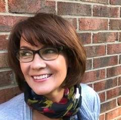Photo of Jamie Klein, salon owner/managing cosmetologist